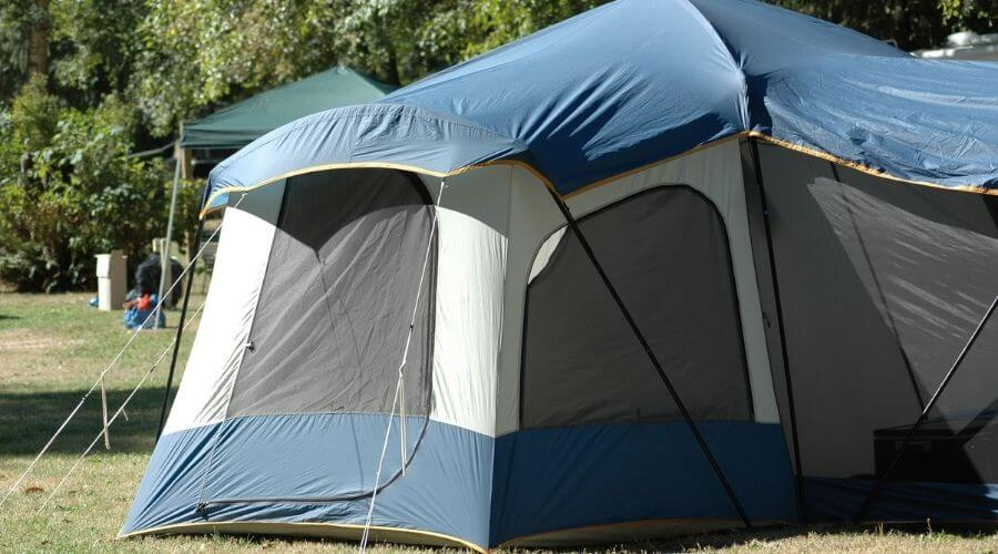 Big blue family tent pitched at the campground in good weather