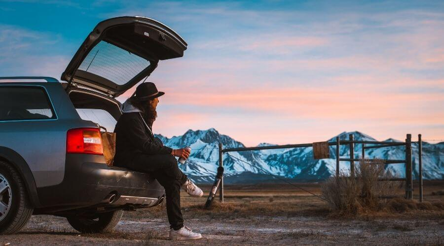 Women enjoying a drink on a cold-weather car camping trip