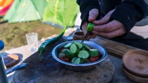 Preparing breakfast on a camping trip with on camping kitchen
