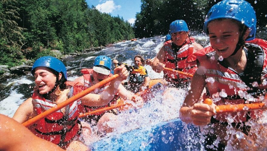 A group of people rafting on the river